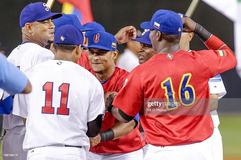 Donovan Solano #17 of Team Colombia shakes hands with Ruben Tejada #11 of Team Panama before Game 5 of the Qualifying Round of the World Baseball Classic between Team Panama and Team Colombia at Rod Carew National Stadium on Sunday, November 18, 2012 in Panama City, Panama.