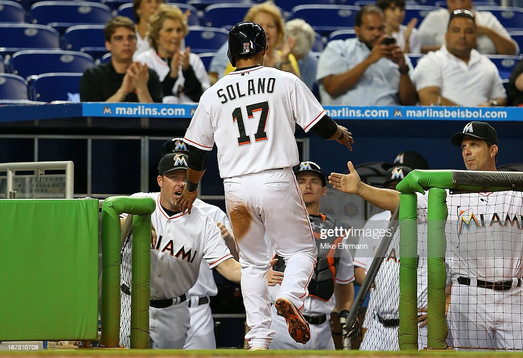Donovan Solano #17 of the Miami Marlins is congratulated after scoring during a game against the Chicago Cubs at Marlins Park on April 25, 2013 in Miami, Florida.