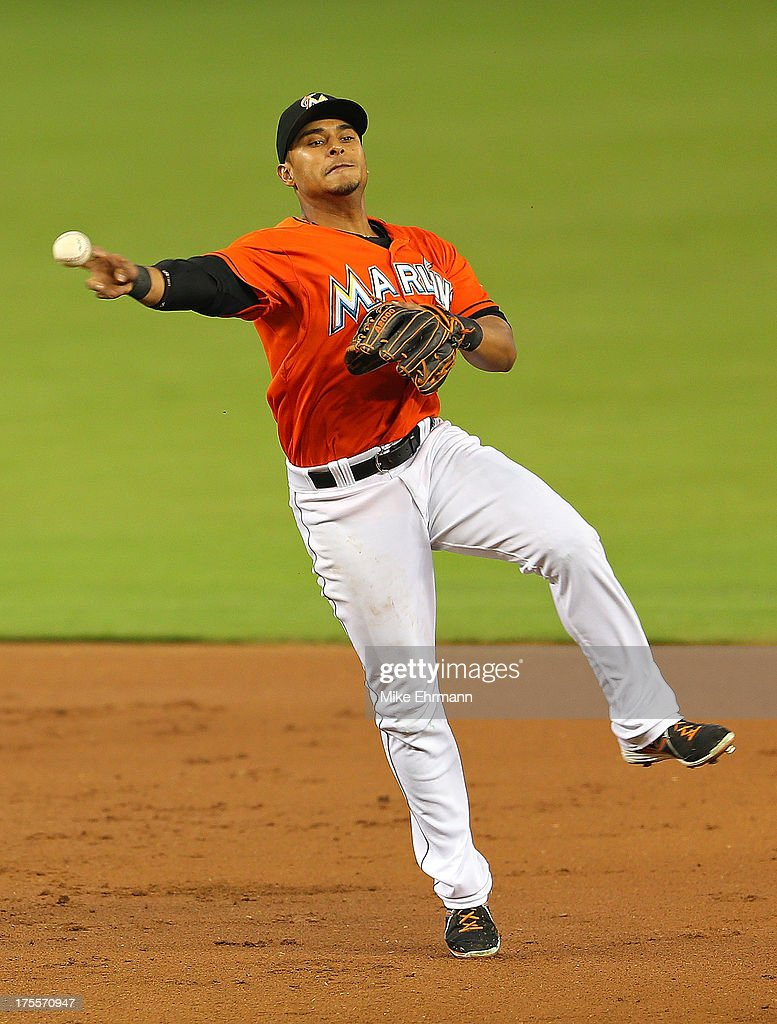 Donovan Solano #17 of the Miami Marlins makes a throw to first during a game against the Cleveland Indians at Marlins Park on August 4, 2013 in Miami, Florida.