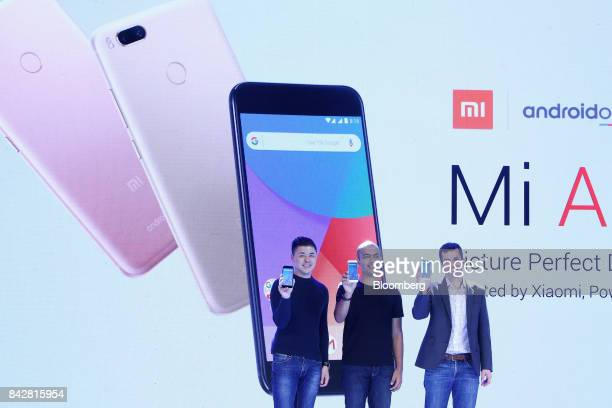 Donovan Sung director of product management and marketing at Xiaomi Corp from left Manu Jain vice president and Jon Gold global director of Android...