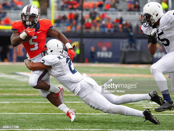 Donovonn Young of the Illinois Fighting Illini runs the ball as Marcus Allen of the Penn State Nittany Lions makes the stop at Memorial Stadium on...