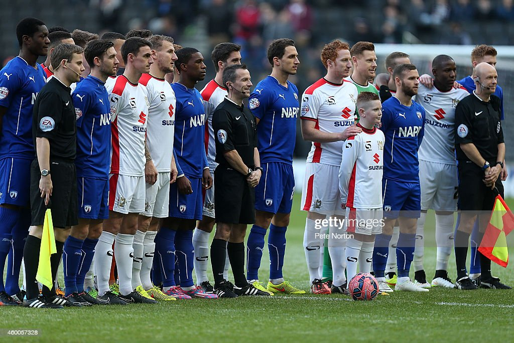 MK Dons and Chesterfield players and match officals pose for the cameras as Football Remembers celebrates the 1914 Christmas Truce prior to kickoff of the FA Cup Second Round match between MK Dons and Chesterfield at Stadium mk on December 6, 2014 in Milton Keynes, England.