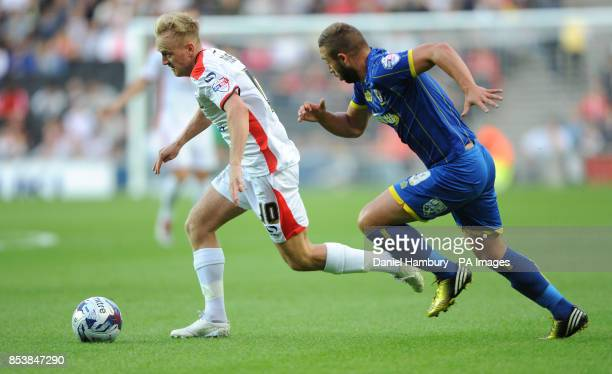 MK Dons' Ben Reeves and AFC Wimbledon's Sammy Moore during the Capital One Cup match at StadiumMK Milton Keynes