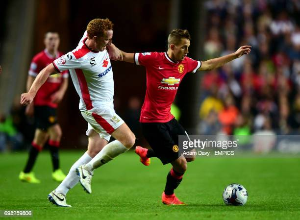 MK Dons' Dean Lewington and Manchester United's Adnan Januzaj battle for the ball