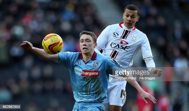 MK Dons' Dele Alli and Tranmere Rovers' Matthew Pennington compete for the ball during the Sky Bet League One match at Stadiummk Milton Keynes
