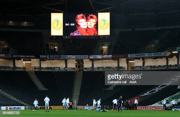 Dons pay tribute to David Bowie who passed away on Monday by showing his image on the giant screen as his music is played during the warm up before...