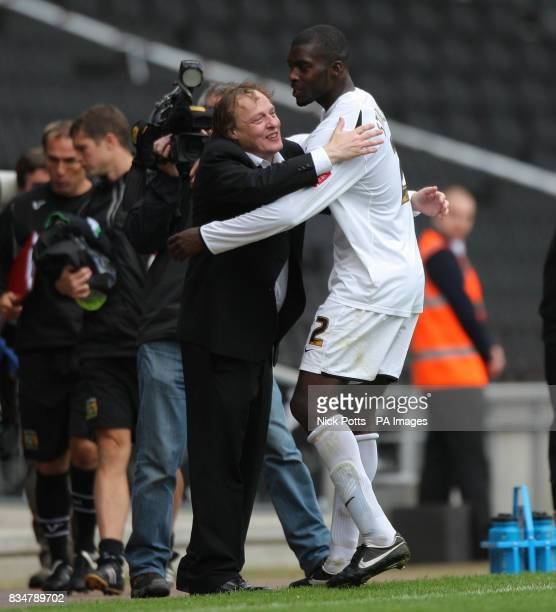 MK Dons's Chairman Peter Winkelman celebrates with Jude Sterling during the CocaCola League One match at the StadiumMK Milton Keynes