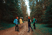 hiking friends in the forest loosing signal at mobile phone.