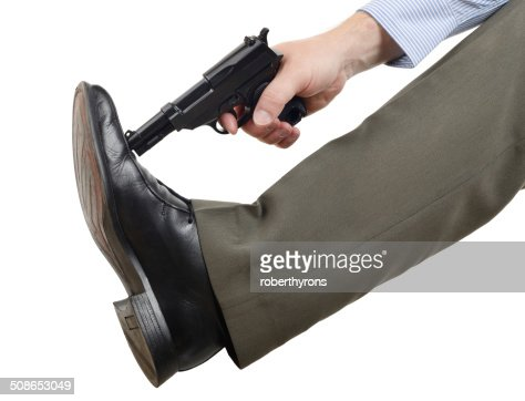 Don't shoot yourself in the foot : Stock Photo
