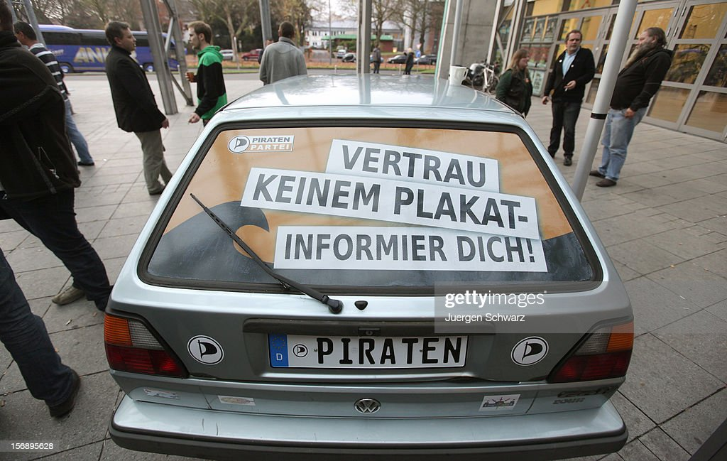 'Don't trust posters, keep informed' is written on a car at the federal party convention of the German Pirates Party (Die Piratenpartei) on November 24, 2012 in Bochum, Germany. The Pirates, after riding an initial surge in popularity last year that landed them seats in several German state parliaments, have since seen their popularity erode as recent scandals and infighting have tarnished the party's image. Germany faces federal elections in 2013.