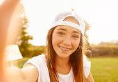 Shot of a teenage girl taking a selfie