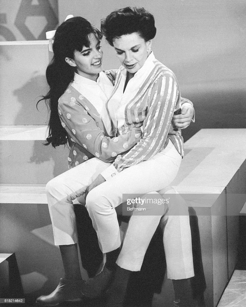 8/3/1963- 'I don't want to be another Judy Garland,' claims Liza Minnelli, who just happens to be the 17-year-old daughter of Judy Garland. Judy and her girl are making their first full-fledged public appearance together in Judy's new CBS-TV show. Here, Mama sits on her big girl's lap during a break in the taping of the video program which will be shown in the fall.