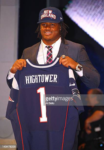 Dont'a Hightower of Alabama holds up a jersey as he stands on stage after he was selected overall by the New England Patriots in the first round of...