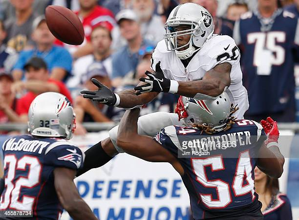 Dont'a Hightower of the New England Patriots breaks up a pass intended for Darren McFadden of the Oakland Raiders during the third quarter at...