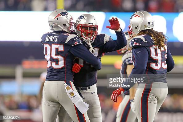 Dont'a Hightower of the New England Patriots celebrates with Chandler Jones and Jabaal Sheard after a play in the second half against the Kansas City...