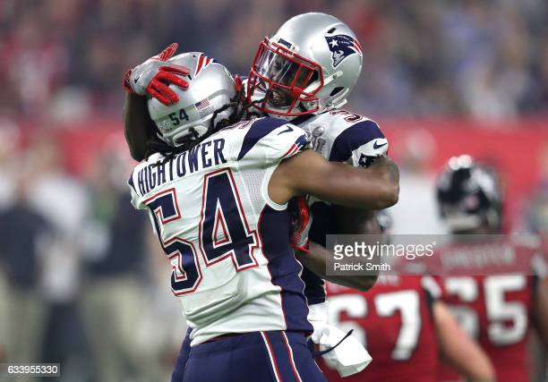 Dont'a Hightower of the New England Patriots celebrates with Devin McCourty after forcing a fumble from Matt Ryan of the Atlanta Falcons during the...