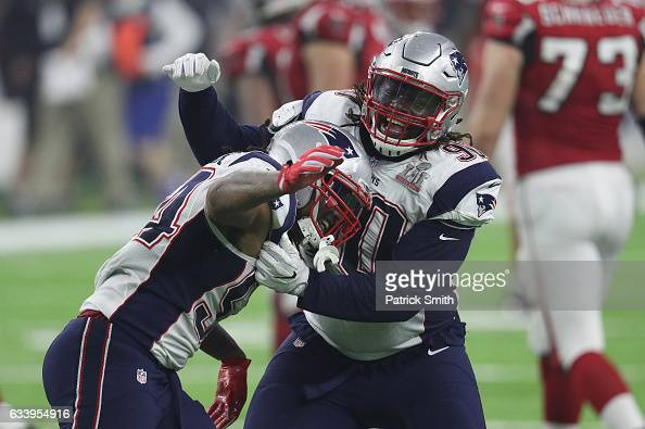 Dont'a Hightower of the New England Patriots celebrates with Malcom Brown after forcing a fumble from Matt Ryan of the Atlanta Falcons during the...