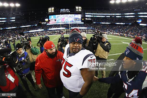 Dont'a Hightower of the New England Patriots greets Vince Wilfork of the Houston Texans after the Patriots defeated the Texans 3416 in the AFC...