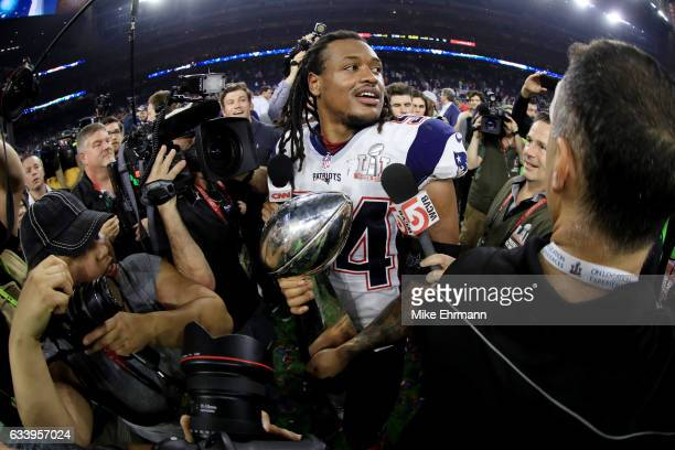 Dont'a Hightower of the New England Patriots holds the Vince Lombardi Trophy after defeating the Atlanta Falcons 3428 in overtime during Super Bowl...