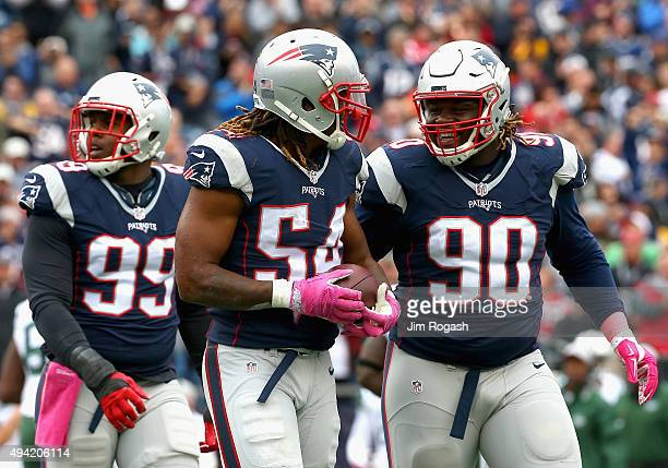 Dont'a Hightower of the New England Patriots reacts after recovering a fumble during the first quarter against the New York Jets at Gillette Stadium...