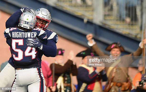 Dont'a Hightower of the New England Patriots reacts with Malcolm Brown after forcing a safety during the third quarter of a game against the...