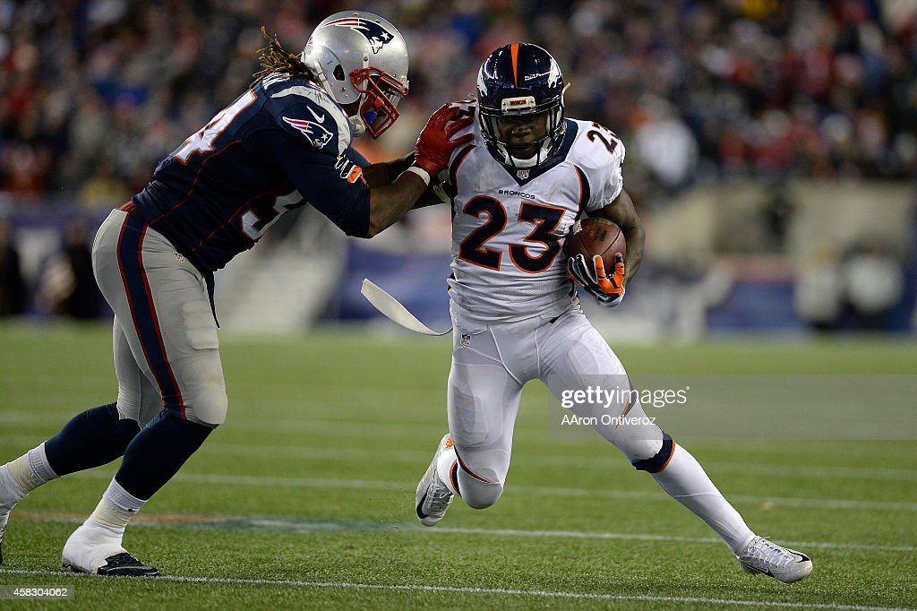 Dont'a Hightower of the New England Patriots tackles Ronnie Hillman of the Denver Broncos during the second half of the Patriots' 4321 win at...