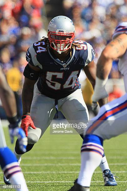Dont'a Hightower of the New England Patriots takes a defensive stance during the second half against the Buffalo Bills at Ralph Wilson Stadium on...
