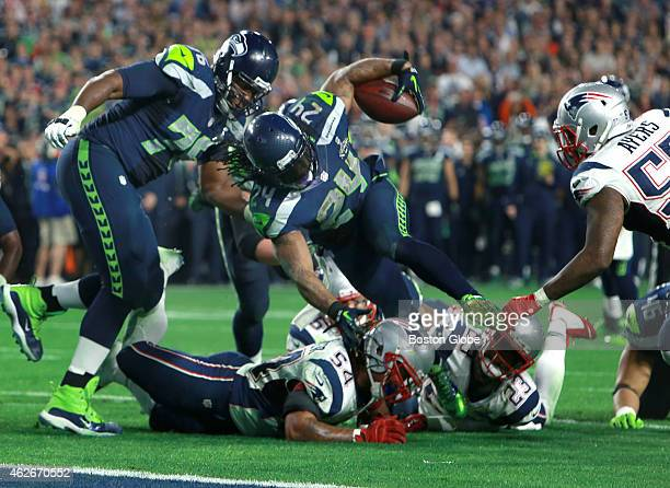 Dont'a Hightower stops Marshawn Lynch at the goal line just before the Butler interception late fourth quarter The New England Patriots plays against...