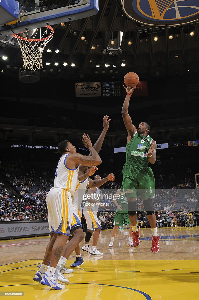 <a gi-track='captionPersonalityLinkClicked' href=/galleries/search?phrase=Donta+Smith&family=editorial&specificpeople=215371 ng-click='$event.stopPropagation()'>Donta Smith</a> #6 of the Maccabi Haifa shoots against <a gi-track='captionPersonalityLinkClicked' href=/galleries/search?phrase=Brandon+Rush+-+Basketball+Player&family=editorial&specificpeople=802089 ng-click='$event.stopPropagation()'>Brandon Rush</a> #4 of the Golden State Warriors on October 11, 2012 at Oracle Arena in Oakland, California.