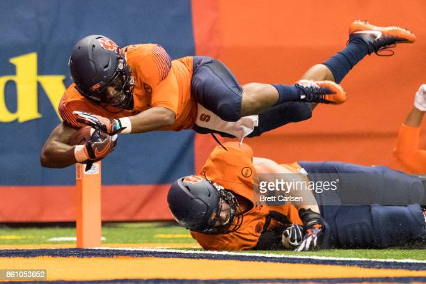 Dontae Strickland of the Syracuse Orange dives into the end zone for a touchdown during the first quarter against the Clemson Tigers at the Carrier...