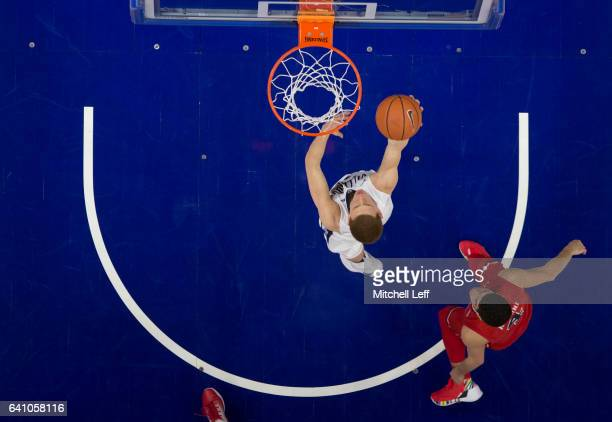Donte DiVincenzo of the Villanova Wildcats attempts a layup against Federico Mussini of the St John's Red Storm at the Wells Fargo Center on February...