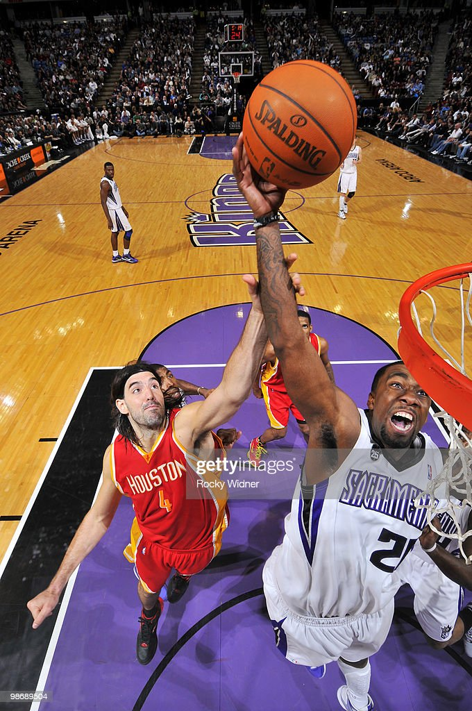 Donte Greene #20 of the Sacramento Kings goes to the hoop with contact from Luis Scola #4 of the Houston Rockets at Arco Arena on April 12, 2010 in Sacramento, California. The Rockets won 117-107.