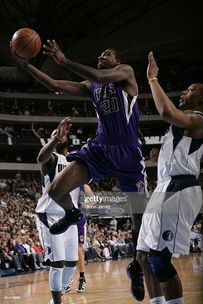 Donte Greene #20 of the Sacramento Kings goes up for a shot against Caron Butler #4 of the Dallas Mavericks during a game at the American Airlines Center on March 5, 2010 in Dallas, Texas.