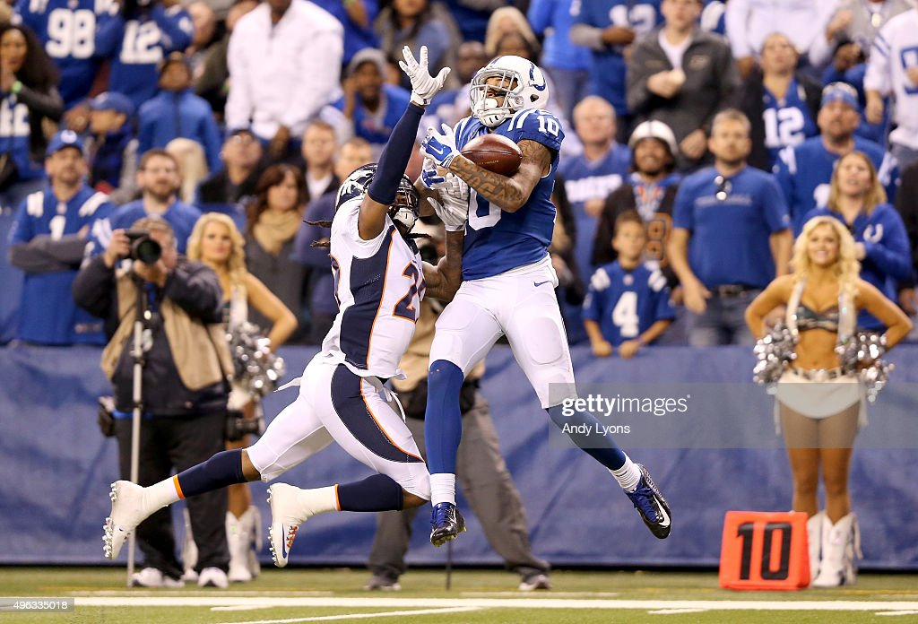 Donte Moncrief #10 of the Indianapolis Colts reaches to catch a pass during the game against the Denver Broncos at Lucas Oil Stadium on November 8, 2015 in Indianapolis, Indiana.