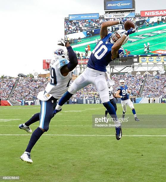 Donte Moncrief of the Indianapolis Colts touchdown against Perrish Cox of the Tennessee Titans in the second half at Nissan Stadium on September 27...