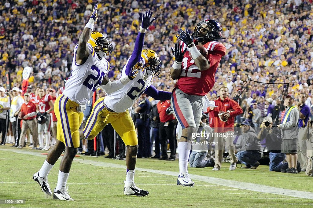 Donte Moncrief #12 of the Ole Miss Rebels catches a touchdown pass over Jalen Mills #28 and Tharold Simon #24 of the LSU Tigers during a game at Tiger Stadium on November 17, 2012 in Baton Rouge, Louisiana.