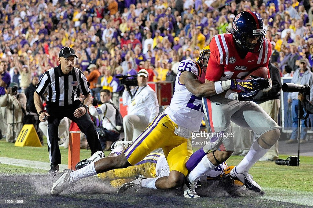 Donte Moncrief #12 of the Ole Miss Rebels scores a touchdown in front of Ronald Martin #26 of the LSU Tigers during a game at Tiger Stadium on November 17, 2012 in Baton Rouge, Louisiana.