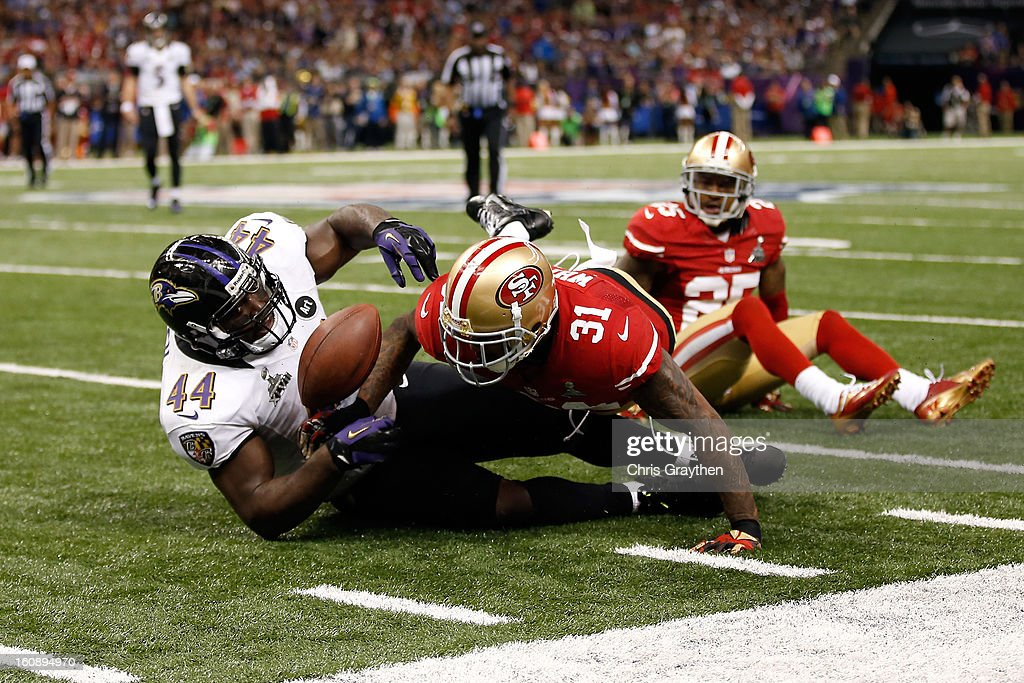 Donte Whitner of the San Francisco 49ers breaks up a play against Vonta Leach of the Baltimore Ravens during Super Bowl XLVII at the MercedesBenz...