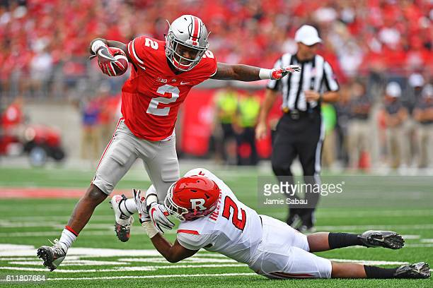 Dontre Wilson of the Ohio State Buckeyes is dropped in the backfield by Kiy Hester of the Rutgers Scarlet Knights in the first quarter at Ohio...