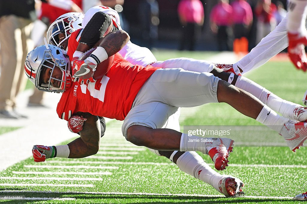 Dontre Wilson of the Ohio State Buckeyes is hauled down for no gain by Tegray Scales of the Indiana Hoosiers in the second quarter at Ohio Stadium on...