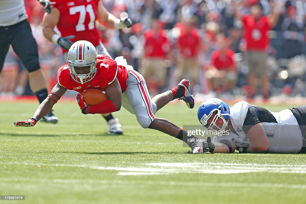 Dontre Wilson #1 of the Ohio State Buckeyes is tackled by Colby Way #34 of the Buffalo Bulls on August 31, 2013 at Ohio Stadium in Columbus, Ohio. Ohio State defeated Buffalo 40-20.
