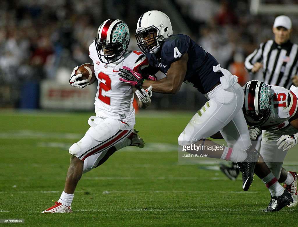Dontre Wilson #2 of the Ohio State Buckeyes rushes against <a gi-track='captionPersonalityLinkClicked' href=/galleries/search?phrase=Adrian+Amos&family=editorial&specificpeople=8489598 ng-click='$event.stopPropagation()'>Adrian Amos</a> #4 of the Penn State Nittany Lions in the second half during the game on October 25, 2014 at Beaver Stadium in State College, Pennsylvania. Ohio State defeated Penn State 31-24 in two overtimes.