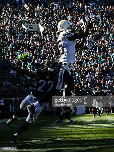 Dontrelle Inman of the San Diego Chargers completes a touchdown reception against the defense of Dwayne Gratz of the Jacksonville Jaguars in the...