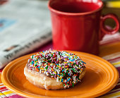USA, Pennsylvania, Lackawanna County, Scranton, Donut, coffee, and morning newspaper