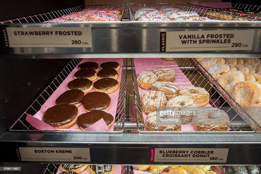 Donuts are displayed at a Dunkin' Donuts Inc. location in Ramsey, New Jersey, U.S., on Thursday, May 5, 2016. Dunkin' Brands Group Inc., a leading franchiser in the quick service restaurants (QSR) sector, operates in almost 60 countries around the world with more than 11,300 Dunkin' Donuts restaurants and 7,500 Baskin-Robbins locations. Photographer: Ron Antonelli/Bloomberg via Getty Images