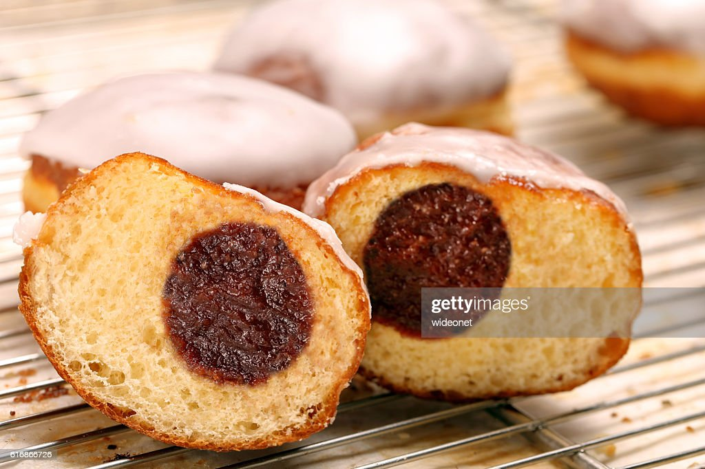 Donuts with jam. Traditional Polish cookies on Fat Thursday : Stock Photo
