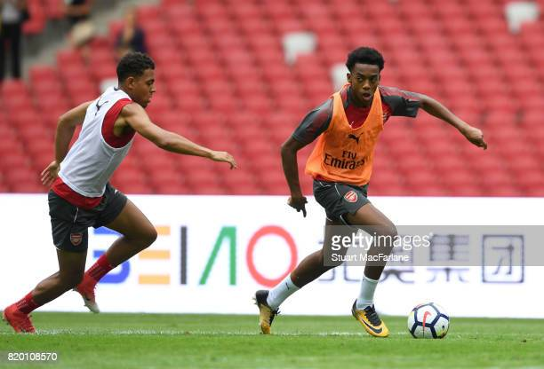 Donyell Malen and Joe Willock of Arsenal during a training session at the Birds Nest stadium on July 21 2017 in Beijing China