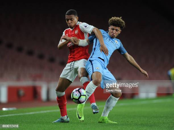Donyell Malen of Arsenal challenges Jadon Sancho of Man City during match between Arsenal and Manchester City at Emirates Stadium on March 13 2017 in...