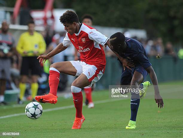 Donyell Malen of Arsenal controls the ball under pressure from Fode Toure of PSG during the UEFA Champions League match between Paris SaintGermain...