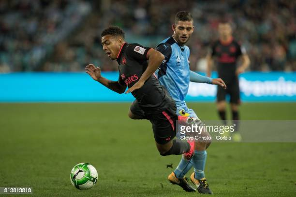 Donyell Malen of Arsenal gets fouled during the match between Sydney FC and Arsenal FC at ANZ Stadium on July 13 2017 in Sydney Australia